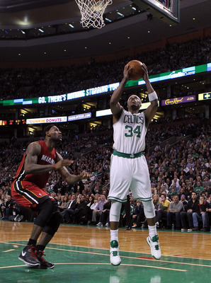 BOSTON - FEBRUARY 13:  LeBron James #6 of the Miami Heat defends as Paul Pierce #34 of the Boston Celtics shots a basket at TD Garden on February 13, 2011 in Boston, Massachusetts. NOTE TO USER: User expressly acknowledges and agrees that, by downloading