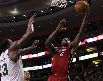 BOSTON - FEBRUARY 13:  LeBron James #6 of the Miami Heat drives  against Kendrick Perkins #43 of the Boston Celtics at TD Garden on February 13, 2011 in Boston, Massachusetts. The Cetics won 85-82. NOTE TO USER: User expressly acknowledges and agrees that