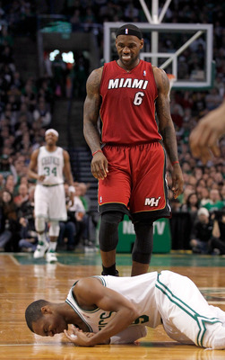 BOSTON - FEBRUARY 13:  LeBron James #6 of the Miami Heat looks at  Rajon Rondo #9 of the Boston Celtics after Rondo fell to the floor at TD Garden on February 13, 2011 in Boston, Massachusetts. NOTE TO USER: User expressly acknowledges and agrees that, by