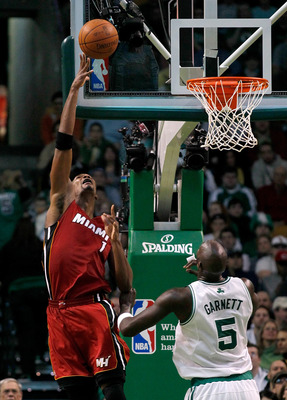 BOSTON - FEBRUARY 13:  Chris Bosh #1 of the Miami Heat goes to the basket against Kevin Garnett #5 of the Boston Celtics at TD Garden on February 13, 2011 in Boston, Massachusetts. NOTE TO USER: User expressly acknowledges and agrees that, by downloading