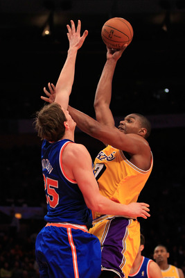 NEW YORK, NY - FEBRUARY 11: Andrew Bynum #17 of the Los Angeles Lakers shoots over Timofey Mozgov #25 of the New York Knicks at Madison Square Garden on February 11, 2011 in New York City. NOTE TO USER: User expressly acknowledges and agrees that, by down