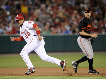 ANAHEIM, CA - AUGUST 27:  Bobby Abreu #53 of the Los Angeles Angels of Anaheim gets caught in a run down with Brad Bergesen #35 of the Baltimore Orioles during the sixth inning on August 27, 2010 in Anaheim, California.  (Photo by Harry How/Getty Images)