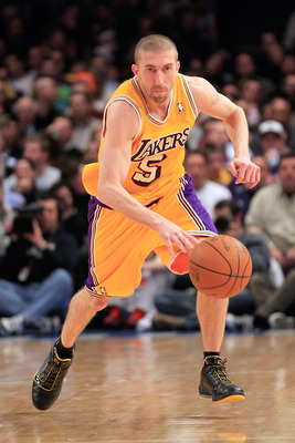 NEW YORK, NY - FEBRUARY 11: Steve Blake #5 of the Los Angeles Lakers dribbles the ball against the New York Knicks at Madison Square Garden on February 11, 2011 in New York City. NOTE TO USER: User expressly acknowledges and agrees that, by downloading an