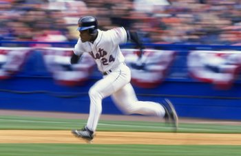 12 Apr 1999:  Outfielder Rickey Henderson #24 of the New York Mets attempts a steal of second base during the game against the Florida Marlins at Shea Stadium in Flushing Meadow, New York. The Mets defeated the Marlins 8-1. Mandatory Credit: Ezra O. Shaw/