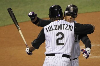 DENVER - SEPTEMBER 27:  Troy Tulowitzki #2 welcomes Carlos Gonzalez #5 of the Colorado Rockies home after his solo home run against the Los Angeles Dodgers at Coors Field on September 25, 2010 in Denver, Colorado.  (Photo by Doug Pensinger/Getty Images)