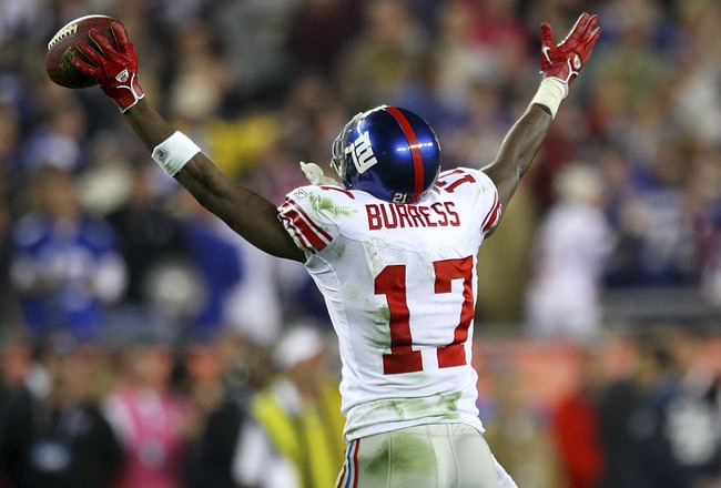 GLENDALE, AZ - FEBRUARY 03:  Wide receiver Plaxico Burress #17 of the New York Giants celebrates after catching a 13-yard touchdown pass in the fourth quarter against the New England Patriots during Super Bowl XLII on February 3, 2008 at the University of