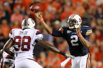 AUBURN, AL - SEPTEMBER 25:  Quarterback Cameron Newton #2 of the Auburn Tigers passes the ball in front of Devin Taylor #98 of the South Carolina Gamecocks at Jordan-Hare Stadium on September 25, 2010 in Auburn, Alabama.  (Photo by Kevin C. Cox/Getty Imag