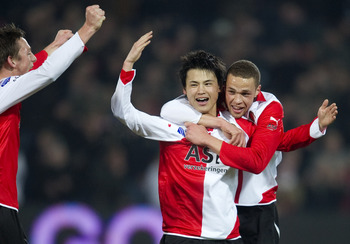 ROTTERDAM, NETHERLANDS - FEBRUARY 12:  Ryo Miyaichi (C) celebrates with Luc Castaignos (R) after his goal (1-0) during the Eredivisie match between Feyenoord and Heracles at the Kuip on February 12, 2011 in Rotterdam, Netherlands.  Feyenoord won with 2-1.