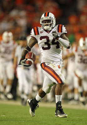 MIAMI - NOVEMBER 20:  Ryan Williams #34 of the Virginia Tech Hokies runs for a touchdown during a game against the Miami Hurricanes at Sun Life Stadium on November 20, 2010 in Miami, Florida.  (Photo by Mike Ehrmann/Getty Images)