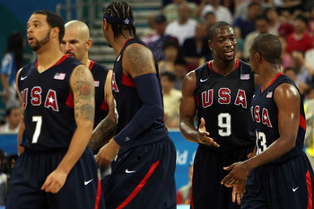 BEIJING - AUGUST 24:  Deron Williams #7, Jason Kidd #5, Carmelo Anthony #15, Dwyane Wade #9 and Chris Paul #13 of the United States walk across the court during the gold medal game against Spain during Day 16 of the Beijing 2008 Olympic Games at the Beiji