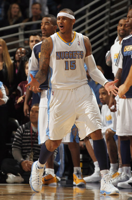 DENVER, CO - FEBRUARY 10:  Carmelo Anthony #15 of the Denver Nuggets reacts after fouling out of the game late in the fourth quarter after a foul on Dirk Nowitzki of the Dallas Mavericks during NBA action at the Pepsi Center on February 10, 2011 in Denver