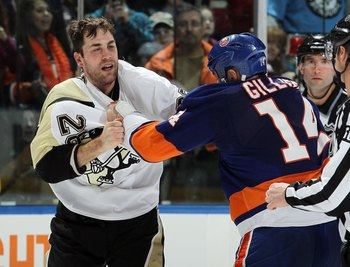 UNIONDALE, NY - FEBRUARY 11:  Trevor Gillies #14 of the New York Islanders fights Eric Godard #28 of the Pittsburgh Penguins on February 11, 2011 at Nassau Coliseum in Uniondale, New York. The Isles defeated the Pens 9-3.  (Photo by Jim McIsaac/Getty Imag