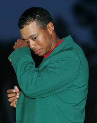 AUGUSTA, GA - APRIL 10:  Tiger Woods wipes a tear back during the green jacket presentation after Woods won The Masters at the Augusta National Golf Club on April 10, 2005 in Augusta, Georgia.  (Photo by Andrew Redington/Getty Images)