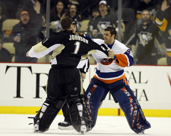 PITTSBURGH, PA - FEBRUARY 02:  Rick DiPietro #39 of the New York Islanders mixes it up against Brent Johnson #1 of the Pittsburgh Penguins at Consol Energy Center on February 2, 2011 in Pittsburgh, Pennsylvania.  The Penguins shut out the Islanders 3-0.