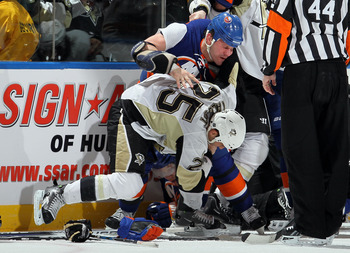 UNIONDALE, NY - FEBRUARY 11:  Zenon Konopka #28 of the New York Islanders fights Maxime Talbot #25 of the Pittsburgh Penguins in the third period on February 11, 2011 at Nassau Coliseum in Uniondale, New York. The Isles defeated the Pens 9-3.  (Photo by J