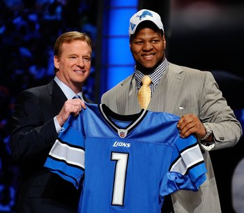 NEW YORK - APRIL 22:  Ndamukong Suh (R) from the Nebraska Cornhuskers poses with NFL Commissioner Roger Goodell as they hold up a Detroit Lions jersey after Suh was selected by the Lions number 2 overall during the first round of the 2010 NFL Draft at Rad
