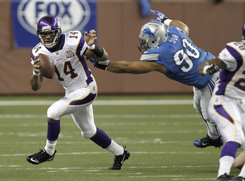 DETROIT, MI - JANUARY 02:  Joe Webb #14 of the Minnesota Vikings runs around the tackle of Ndamukong Suh #90 of the Detroit Lions at Ford Field on January 2, 2011 in Detroit, Michigan.  (Photo by Gregory Shamus/Getty Images)