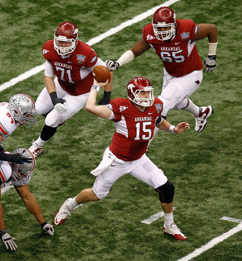 NEW ORLEANS, LA - JANUARY 04:  Quarterback Ryan Mallett #15 of the Arkansas Razorbacks throws the ball in the first quarter against the Ohio State Buckeyes during the Allstate Sugar Bowl at the Louisiana Superdome on January 4, 2011 in New Orleans, Louisi