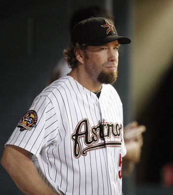 HOUSTON - AUGUST 30:  Houston Astros hitting coach Jeff Bagwell #5 looks on from the dugout at Minute Maid Park during a game against the St. Louis Cardinals on August 30, 2010 in Houston, Texas.  (Photo by Bob Levey/Getty Images)