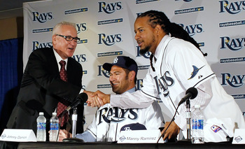 ST PETERSBURG, FL - FEBRUARY 01:  The Tampa Bay Rays manager Joe Maddon shakes hands with Manny Ramirez #24 of the Tampa Bay Rays as Johnny Damon #22 of the Tampa Bay Rays looks on during a press conference at Tropicana Field on February 1, 2011 in St. Pe