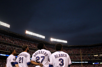 ARLINGTON, TX - NOVEMBER 01:  (L-R) Nelson Cruz #17, Jeff Francoeur #21, Vladimir Guerrero #27 and Andres Blanco #3 of the Texas Rangers stand for the performance of the National Anthem against the San Francisco Giants in Game Five of the 2010 MLB World S