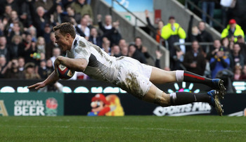 LONDON, ENGLAND - FEBRUARY 12:  Chris Ashton of England dives over for his fourth try during the RBS Six Nations match between England and Italy at Twickenham Stadium in London, England  (Photo by David Rogers/Getty Images)