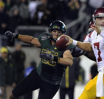 EUGENE, OR - OCTOBER 31: Quarterback Matt Barkley #7 of the USC Trojans sets to throw a pass as linebacker Casey Matthews #55 of the Oregon Ducks applies pressure in the third quarter of the game at Autzen Stadium on October 31, 2009 in Eugene, Oregon. Or