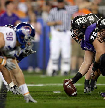 GLENDALE, AZ - JANUARY 04:  Jake Kirkpatrick #76 of the TCU Horned Frogs gets ready to hike the football in the first half against the Boise State Broncos during the Tostitos Fiesta Bowl at the Universtity of Phoenix Stadium on January 4, 2010 in Glendale