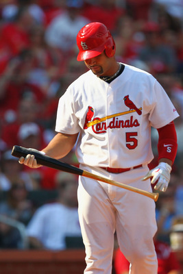 ST. LOUIS - SEPTEMBER 18: Albert Pujols #5 of the St. Louis Cardinals returns to the dugout after striking out against the San Diego Padres at Busch Stadium on September 18, 2010 in St. Louis, Missouri.  The Padres beat the Cardinals 8-4.  (Photo by Dilip