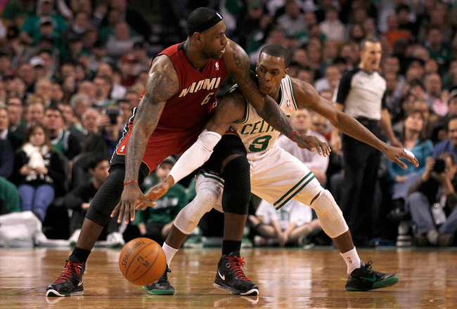 BOSTON - FEBRUARY 13:  LeBron James #6 of the Miami Heat battles Rajon Rondo #9 of the Boston Celtics for control of the ball at TD Garden on February 13, 2011 in Boston, Massachusetts. NOTE TO USER: User expressly acknowledges and agrees that, by downloa