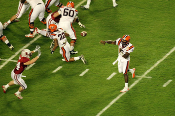 MIAMI, FL - JANUARY 03:  Tyrod Taylor #5 of the Virginia Tech Hokies throws a pass against the Stanford Cardinal during the 2011 Discover Orange Bowl at Sun Life Stadium on January 3, 2011 in Miami, Florida. Stanford won 40-12.  (Photo by Mike Ehrmann/Get