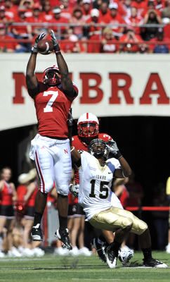LINCOLN, NEBRASKA - SEPTEMBER 11: Nebraska Cornhuskers defensive back DeJon Gomes #7 and safety Rickey Thenarse #3 knock a pass away from Idaho Vandals wide receiver Marsel Posey #15 during first half action of their game at Memorial Stadium on September