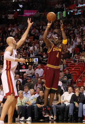 MIAMI, FL - JANUARY 31:  Antawn Jamison #4 of the  Cleveland Cavaliers shoots over Zydrunas Ilgauskas #11 of the Miami Heat during a game against at American Airlines Arena on January 31, 2011 in Miami, Florida. NOTE TO USER: User expressly acknowledges a