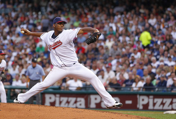CLEVELAND - JULY 28:  Fausto Carmona #55 of the Cleveland Indians throws a second inning pitch while playing the New York Yankees on July 28, 2010 at Progressive Field in Cleveland, Ohio.  (Photo by Gregory Shamus/Getty Images)