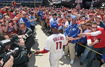 PHILADELPHIA - APRIL 12: Jimmy Rollins #11 of the Philadelphia Phillies greets fans while walking down to the field before the game against the Washington Nationals on Opening Day at Citizens Bank Park on April 12, 2010 in Philadelphia, Pennsylvania. Roll