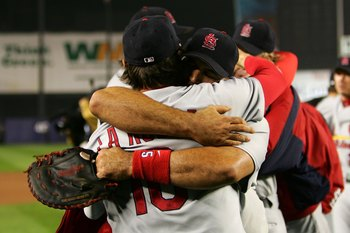NEW YORK - OCTOBER 19: Albert Pujols #5 and manager Tony LaRussa #10 of the St. Louis Cardinals embrace after defeating the New York Mets 3 to 1 in game seven of the NLCS at Shea Stadium on October 19, 2006 in the Flushing neighborhood of the Queens borou