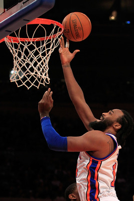 NEW YORK, NY - JANUARY 24 : Ronny Turiaf #14 of the New York Knicks lays the ball up against the Washington Wizards at Madison Square Garden on January 24, 2011 in New York City. NOTE TO USER: User expressly acknowledges and agrees that, by downloading an