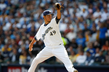MILWAUKEE, WI - APRIL 05: Pitcher Yovani Gallardo #49 of the Milwaukee Brewers pitches the baseball against the Colorado Rockies at the Miller Park on April 05, 2010 in Milwaukee, Wisconsin. The Rockies defeated the Brewers 5-3.(Photo by Scott Boehm/Getty