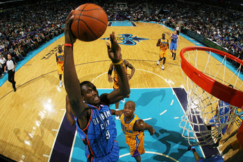 NEW ORLEANS, LA - DECEMBER 10: Serge Ibaka #9  of the Oklahoma City Thunder dunks the ball over Jarrett Jack #2 of the New Orleans Hornets at New Orleans Arena on December 10, 2010 in New Orleans, Louisiana.    NOTE TO USER: User expressly acknowledges an