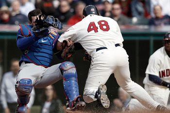 CLEVELAND, OH- APRIL 12: Taylor Teagarden #2 of the Texas Rangers tags out Travis Hafner #48 of the Cleveland Indians while colliding with him at home plate during the Opening Day game on April 12, 2010 at Progressive Field in Cleveland, Ohio.  (Photo by