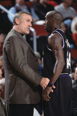 19 Dec 2001:  Guard Bobby Jackson #24 of the Sacramento Kings listens to head coach Rick Adelman during the NBA game against the Seattle SuperSonics at Key Arena in Seattle, Washington.  The SuperSonics defeated the Kings 104-92.Mandatory Credit:  Otto Gr