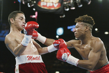 LAS VEGAS - JUNE 22:  Fernando Montiel (L) weaves back  to avoid a blow by Pedro Alcazar in their WBO Super Flyweight Championship fight on June 22, 2002 at the MGM Grand in Las Vegas, Nevada.  Montiel won with a sixth round technical knockout.  Alcazar c