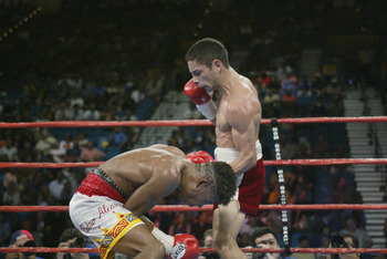 LAS VEGAS - JUNE 22:  Fernando Montiel (R) hovers over a defenseless  Pedro Alcazar in their WBO Super Flyweight Championship fight on June 22, 2002 at the MGM Grand in Las Vegas, Nevada.  Montiel won with a sixth round technical knockout.  Alcazar collap