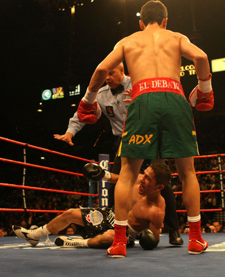 LAS VEGAS - FEBRUARY 16:  Martin Castillo of Mexico is knocked down by Fernando Montiel of Mexico  during their WBO super flyweight championship fight at the MGM Grand Garden Arena on February 16, 2008 in Las Vegas, Nevada.  (Photo by Jed Jacobsohn/Getty