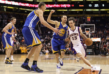PHOENIX, AZ - FEBRUARY 10:  Steve Nash #13 of the Phoenix Suns drives the ball past Stephen Curry #30 of the Golden State Warriors during the NBA game at US Airways Center on February 10, 2011 in Phoenix, Arizona.  NOTE TO USER: User expressly acknowledge