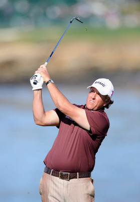 PEBBLE BEACH, CA - FEBRUARY 13:  Phil Mickelson plays his tee shot on the seventh hole during the final round of the AT&T Pebble Beach National Pro-Am at Pebble Beach Golf Links on February 13, 2011  in Pebble Beach, California.  (Photo by Stuart Franklin