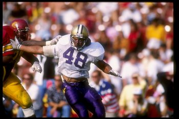 9 Nov 1991: Linebacker Donald Jones of the Washington Huskies tries to break through the line during a game against the Southern California Trojans at the Los Angeles Memorial Coliseum in Los Angeles, California. Washington won the game 14-3.