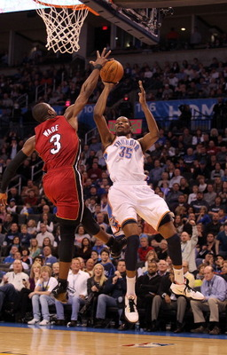 OKLAHOMA CITY, OK - JANUARY 30:  Forward Kevin Durant #35 of the Oklahoma City Thunder takes a shot against Dwyane Wade #3 of the Miami Heat at Ford Center on January 30, 2011 in Oklahoma City, Oklahoma.  NOTE TO USER: User expressly acknowledges and agre