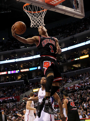 LOS ANGELES, CA - FEBRUARY 02:  Derrick Rose #1 of the Chicago Bulls shoots against the Los Angeles Clippers at Staples Center on February 2, 2011  in Los Angeles, California.  NOTE TO USER: User expressly acknowledges and agrees that, by downloading and