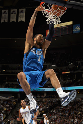 DENVER, CO - FEBRUARY 10:  Tyson Chandler #6 of the Dallas Mavericks dunks the ball against the Denver Nuggets during NBA action at the Pepsi Center on February 10, 2011 in Denver, Colorado. NOTE TO USER: User expressly acknowledges and agrees that, by do